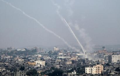 Palestinian rockets arcing from Gaza City towards Israel, July 14.