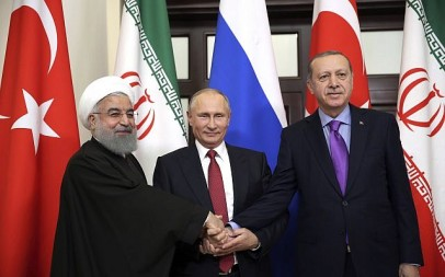 Turkey's President Recep Tayyip Erdogan, (r), Russia's President Vladimir Putin, (c), and Iran's President Hassan Rouhani pose for the media members in Sochi, Russia, November 22. 2017. (Kayhan Ozer/Pool via AP)