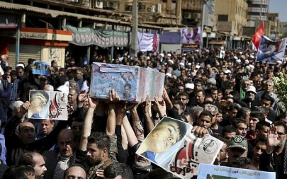 People attend a mass funeral for those who died in Saturday's attack on a military parade in the southwestern city of Ahvaz, that killed 25 people, in Ahvaz, Iran, Monday, Sept. 24, 2018 (AP Photo/Ebrahim Noroozi)