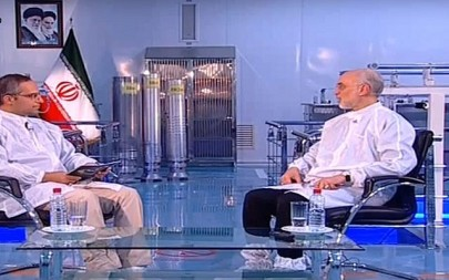 Screen capture from video showing Ali Akbar Salehi, the head of Iran's nuclear agency, right, and three Iranian produced uranium enrichment centrifuges in the center background. (YouTube)