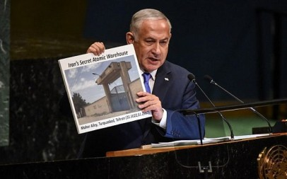 Benjamin Netanyahu, Prime Minister of Israel, holds up a placard showing a suspected Iranian atomic site while delivering a speech at the United Nations during the United Nations General Assembly on September 27, 2018 in New York City. (Stephanie Keith/Getty Images/AFP)