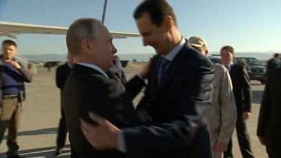 Putin (L) and Assad's meeting at Russia's Hmeymim air base in Syria's Latakia Province (Photo: AP, Presidential TV)