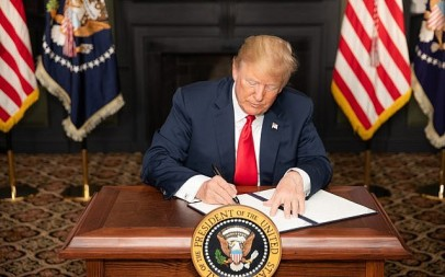 President Donald J. Trump signs an EO on Iran Sanctions in the Green Room at Trump National Golf Club Monday, August 6, 2018, in Bedminster Township, New Jersey. (Official White House Photo by Shealah Craighead)