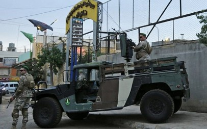 Lebanese security forces guard the entrance of Al-Ahed stadium in Beirut's southern suburbs during a tour organized by the Lebanese foreign minister for ambassadors on October 1, 2018 of alleged missile sites around the Lebanese capital in a bid to disprove Israeli accusations that the Hezbollah movement has secret missile facilities there. (AFP PHOTO / ANWAR AMRO)