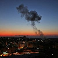 Smoke billows following Israeli air strikes targeting Rafah in the southern Gaza Strip, near the border with Egypt, on November 12, 2018. (Photo by SAID KHATIB / AFP)