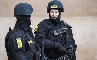 Illustrative: Danish policemen stand guard in front of the city court in Copenhagen, Denmark, on March 10, 2016. (AFP/SCANPIX DENMARK/Emil Hougaard)