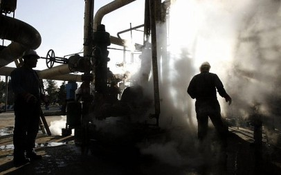 In this Nov. 17, 2007 file photo, a worker repairs a part of a unit of the Tehran oil refinery, in Tehran, Iran. (AP Photo/Vahid Salemi, File)
