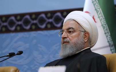 In this photo released by official website of the office of the Iranian Presidency, President Hassan Rouhani attends an annual Islamic Unity Conference in Tehran, Iran, Saturday, Nov. 24, 2018. (Iranian Presidency Office via AP)