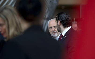 Iranian Foreign Minister Mohammad Javad Zarif, center, speaks with Lebanon's Prime Minister Saad Hariri, right, after a group photo at a conference 'Supporting the future of Syria and the region' at the Europa building in Brussels on Wednesday, April 25, 2018. (AP Photo/Virginia Mayo)
