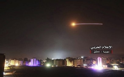 Syrian anti-aircraft missiles rise into the sky as Israeli missiles hit air defense positions and other military bases, in Damascus, Syria, on May 10, 2018. (Government-controlled Syrian Central Military Media, via AP)