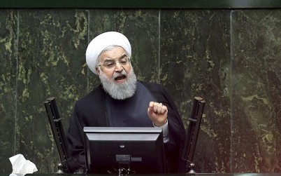 Iranian President Hassan Rouhani speaks during parliament's open session on confidence vote for four new ministers, in Tehran, Iran, October 27, 2018. (Ebrahim Noroozi/AP)