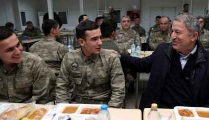 Turkey's defense minister speaks with soldiers during a visit to Turkish troops stationed at the border with Syria, Kilis, Turkey, December 31, 2018.