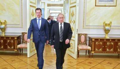 File Photo: Russian President Vladimir Putin greets his Syrian counterpart Bashar al-Assad upon his arrival for a meeting in Moscow, Russia, October 21, 2015.