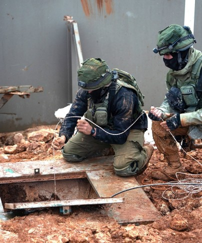 IDF troops uncovering a Hezbollah tunnel dug from Lebanon into Israel