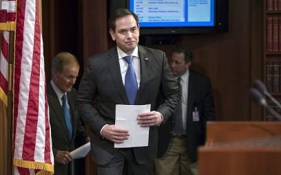 Sen. Marco Rubio (Republican, Florida), center, arrives for a news conference at the Capitol in Washington, March 7, 2018. (J. Scott Applewhite/AP)
