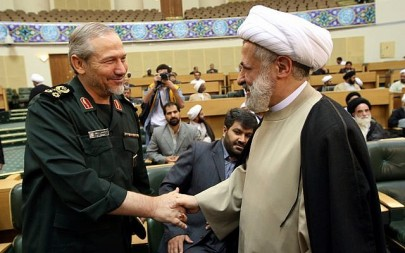 Commander-in-chief of Iran's Islamic Revolutionary Guards Corp, (IRGC) Major General Yahya Rahim Safavi, left, greets Sheikh Naim Qassem, deputy Secretary General of Lebanons Hezbollah, during a religious ceremony in Tehran, Iran, on August 18, 2007. (AP Photo/Hasan Sarbakhshian)