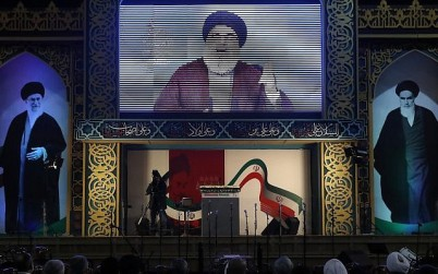 Hezbollah leader Hassan Nasrallah delivers a live broadcast speech, during a rally to commemorate the 40th anniversary of Iran's Islamic Revolution, in southern Beirut, Lebanon, Wednesday, Feb. 6, 2019. (AP Photo/Hussein Malla)
