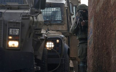 An Israeli soldier stands guard in the northern West Bank village of Salem, east of Nablus, on March 18, 2019, during a search operation for a Palestinian suspect. (JAAFAR ASHTIYEH / AFP)