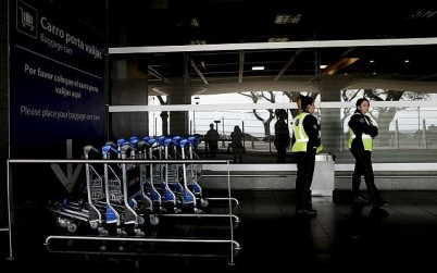 Police stand outside the airport in Buenos Aires, Argentina, Tuesday, Sept. 25, 2018. (AP/Natacha Pisarenko)