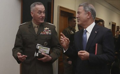 The US chairman of the Joint Chiefs of Staff, Gen. Joseph Dunford, left, and Turkey's Defence Minister Hulusi Akar speak during a meeting, in Ankara, Turkey, Tuesday, Jan. 8, 2019. (Turkish Defence Ministry via AP)