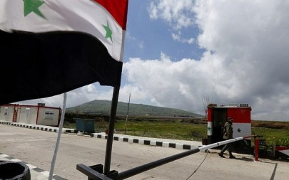 A member of the Syrian security forces walks near the border post with Israel in the Syrian town of Quneitra on the Golan Heights on March 26, 2019. (Louai Beshara/AFP)