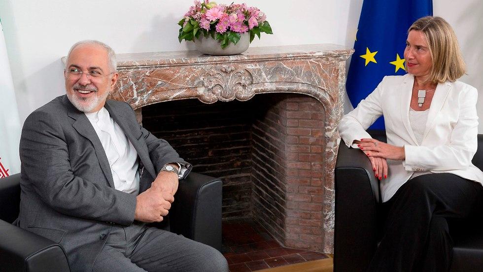 EU Foreign Policy Chief Federica Mogherini and Iranian FM Javad Zarif (Photo: AFP)