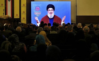 Supporters of the Iranian-backed Hezbollah terror group listen to a speech of Hezbollah leader Sayyed Hassan Nasrallah, via a video link, in a southern suburb of Beirut, Lebanon, March 8, 2019. (AP Photo/Bilal Hussein)