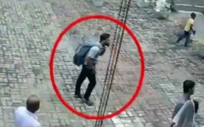 Security camera footage shows a suicide bomber, carrying a backpack, seconds before entering a church in Negombo, Sri Lanka, on April 21, 2019. (screen capture: Twitter)