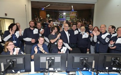 Engineers celebrate in the Beresheet control room in Yehud on April 4, 2019 after announcing the moon's gravitation pull has most likely successfully captured the Beresheet spacecraft, the most complicated maneuver that the spacecraft has executed since its launch. (Eliran Avital/courtesy Beresheet)