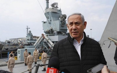 Illustrative: Prime Minister Benjamin Netanyahu speaks to journalists during a visit to inspect a naval Iron Dome defense system in the northern port of Haifa on February 12, 2019. (Jack Guez/Pool/AFP)