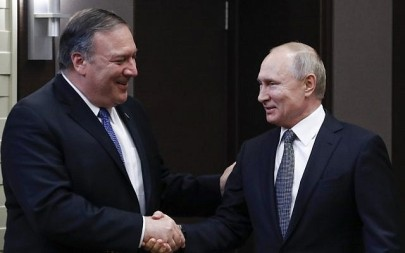 Russian President Vladimir Putin, right, meets with US Secretary of State Mike Pompeo at the Bocharov Ruchei residence in Sochi on May 14, 2019. (Pavel Golovkin/POOL/AFP)