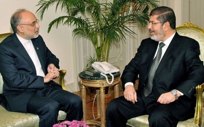 Egyptian President Mohammed Morsi, right, meets with Iranian Foreign Minister Ali Akbar Salehi at the Presidential Palace in Cairo, Egypt, Tuesday, Sept. 18, 2012. (photo credit: AP/Egyptian Presidency)