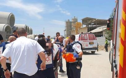 Magen David Adom paramedics treat a factory worker injured in a rocket strike in Ashkelon on May 5, 2019. (courtesy Magen David Adom)