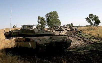 Israeli soldiers manoeuver Merkava tanks in the Israeli-annexed Golan Heights on June 2, 2019. (Photo by JALAA MAREY / AFP)