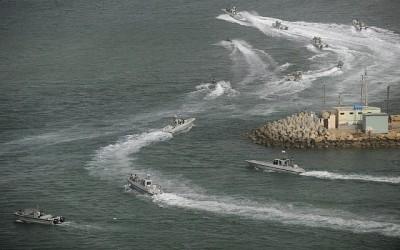 Illustrative: Iranian navy speed boats attend a drill in the sea of Oman, on Friday, Dec. 30, 2011.(AP/IIPA, Ali Mohammadi)