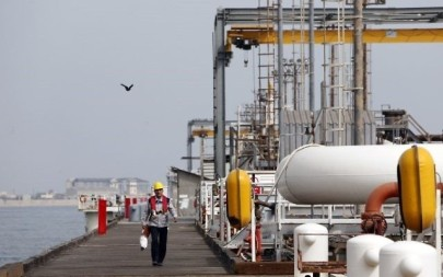 This photo from March 12, 2017, shows an Iranian laborer walking the platform of the oil facility in the Khark Island, on the shore of the Gulf. (AFP/Atta Kenar)