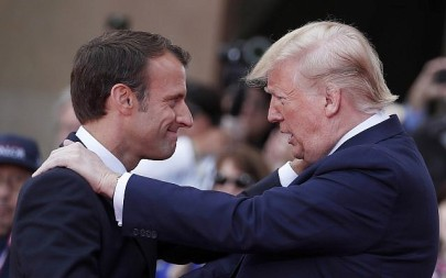 French President Emmanuel Macron, left, meets US President Donald Trump during a ceremony to mark the 75th anniversary of D-Day at the Normandy American Cemetery in Colleville-sur-Mer, Normandy, France, June 6, 2019. (Ian Langsdon/POOL via AP)