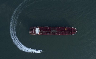 In this July 21, 2019 photo, an aerial view shows a speedboat of Iran's Revolutionary Guard moving around the British-flagged oil tanker Stena Impero which was seized in the Strait of Hormuz on Friday by the Guard, in the Iranian port of Bandar Abbas. (Morteza Akhoondi/Tasnim News Agency via AP)