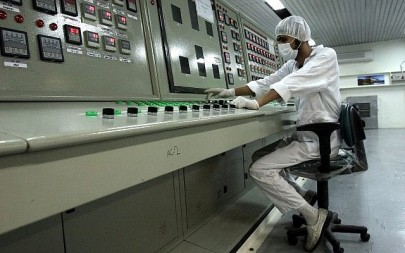 In this February 3, 2007, file photo, an Iranian technician works at the Uranium Conversion Facility just outside the city of Isfahan 255 miles (410 kilometers) south of the capital Tehran, Iran. (AP Photo/Vahid Salemi, File)