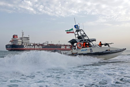 An Iranian Revolutionary Guard jet boat sails around the seized British-flagged tanker Stena Impero in Bandar Abbas
