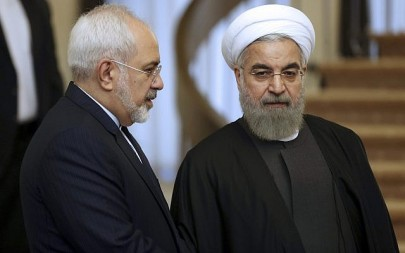 In this photo from November 24, 2015, Iranian President Hassan Rouhani, right, listens to his Foreign Minister Mohammad Javad Zarif prior to a meeting in Tehran, Iran. (AP Photo/Vahid Salemi, File)