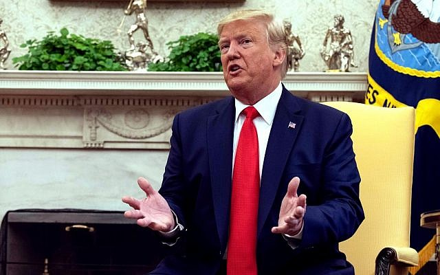 US President Donald Trump speaks to reporters in the Oval Office at the White House in Washington, on September 11, 2019. (Nicholas Kamm/AFP)