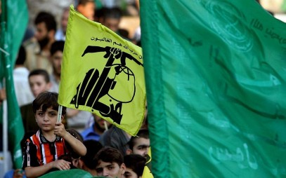 Hamas supporters in Gaza hold Hezbollah and Islamic flags as they demonstrate against Israel  during the Second Lebanon War on July 30, 2006. (AP/Khalil Hamra)