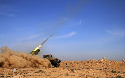 Soldiers from the Syrian army fire a rocket at Islamic State group positions in the province of Raqqa, Syria, on February 17, 2016. (Alexander Kots/Komsomolskaya Pravda via AP, File)
