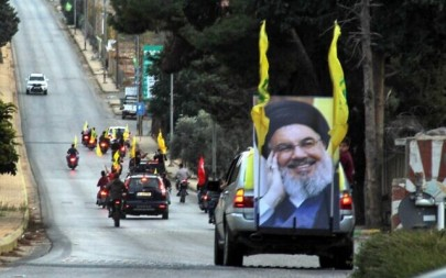 Supporters of the Hezbollah terror group drive in a convoy in support of its leader Hassan Nasrallah's speech, in the area of Fatima's Gate in Kfar Kila on the Lebanese border with Israel, October 25, 2019. (Ali Dia/AFP)