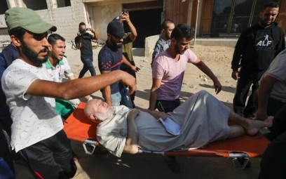 Palestinian evacuate a wounded man in Gaza City on November 12, 2019, after an Israeli airstrike killed a commander of the Palestinian Islamic Jihad terror group. (MAHMUD HAMS / AFP)