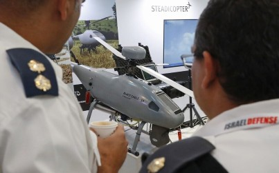In this photo taken on November 7, 2019, visitors examine exhibits at the 8th International Conference and Exhibition on Unmanned Systems (UVID) at Airport City, near Tel Aviv. (JACK GUEZ / AFP)
