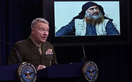 "US Marine Corps Gen. Kenneth ""Frank"" McKenzie, commander of US Central Command, speaks as a picture of Abu Bakr al-Baghdadi is seen during a press briefing October 30, 2019 at the Pentagon in Arlington, Virginia. (Alex Wong/Getty Images/AFP)"