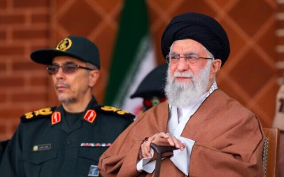 In this picture released by an official website of the office of the Iranian supreme leader, Supreme Leader Ayatollah Ali Khamenei, right, reviews armed forces with Chief of the General Staff of the Armed Forces Gen. Mohammad Hossein Bagheri, during a graduation ceremony at Iran's Air Defense Academy, in Tehran, Iran, October 30, 2019. (Office of the Iranian Supreme Leader via AP)