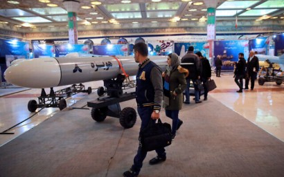 Visitors look at a Hoveizeh 8 cruise missile at a military show marking the 40th anniversary of Iran's Islamic Revolution in Tehran, Iran, February 3, 2019.  (AP/Vahid Salemi)